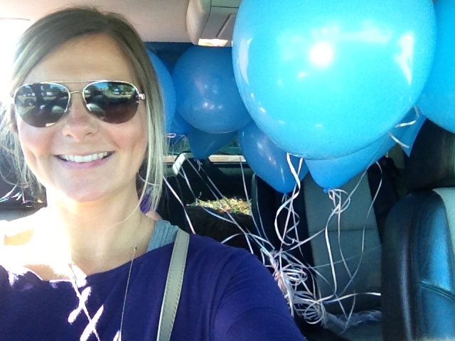 Car full of blue balloons to celebrate his LIFE exactly one year later.